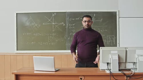 Maths Professor Teaching Geometry in Auditorium