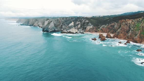 Thumbnail for Azure Ocean Waves Roll on Empty Sea Coast with Cliff Rocks, Cabo Da Roca (Portugal)
