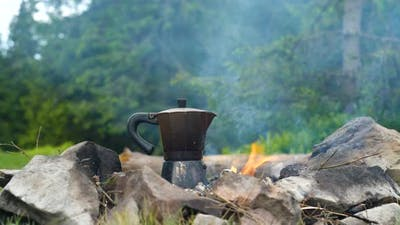 Coffee is Prepared in a Geyser Coffee Maker on a Campfire in the Forest