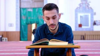 Teen Read Quran Mosque
