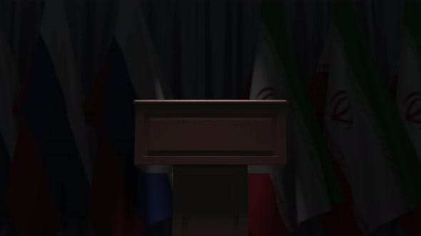 Many Flags of Iran and Russia Behind Speaker Tribune