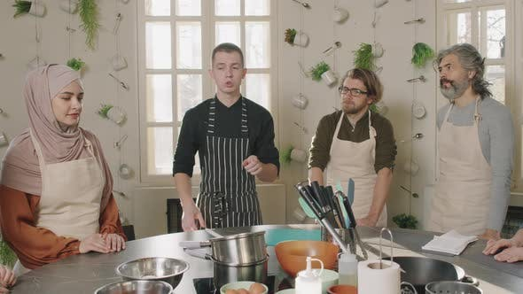 Chef Teaching People Cooking