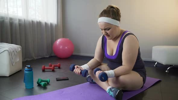 Thumbnail for Fat Girl Lifting Dumbbells to Strength Arms Muscles, Doing Difficult Exercises