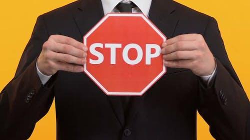 Man Showing Stop Sign, Prevention of Sex Harassment at Work, Discrimination