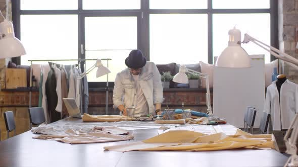 Thumbnail for Male Fashion Designer Drawing Sketch in Sewing Studio