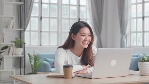 Girl With Laptop Computer Having Video Call And Working At Home Office