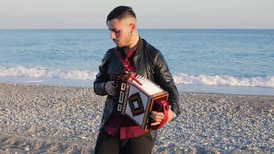 Playing Accordion on the Beach
