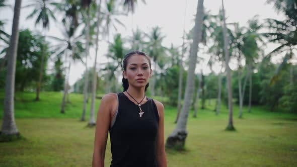 Thumbnail for Asian Woman Meditating in the Jungle