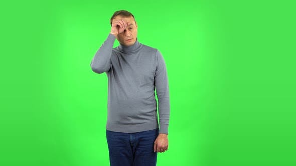 Thumbnail for Male Is Tired and Sighs. Green Screen