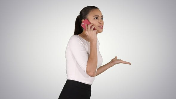Thumbnail for Stressed businesswoman with mobile phone making a call
