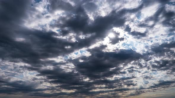Thumbnail for Dramatic Cumulus Cirrus Clouds Move in the Blue Sky. Sunbeams Shine. Time Lapse
