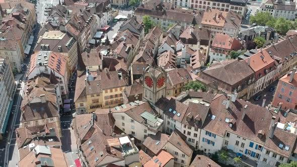 Thumbnail for Aerial Panoramic Shot of Old Architecture Circling Clock Tower in the Center of Ancient Neuchatel
