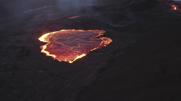 Drone Over Pool Of Molten Lava From Erupting Fagradalsfjall Volcano