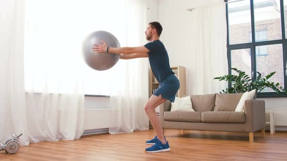 Thumbnail for Man Exercising and Doing Squats with Ball at Home 65