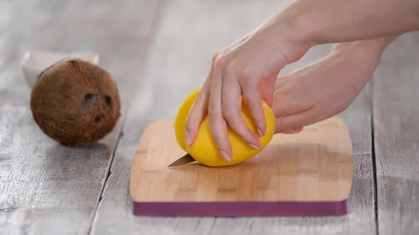 Thumbnail for Closeup of woman cutting mango