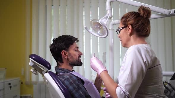 Thumbnail for Patient Looking in Mirror After Dental Treatment