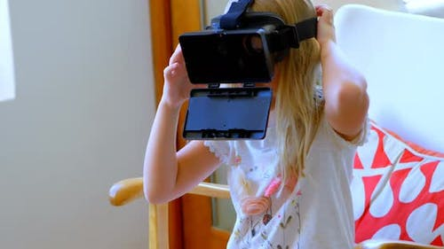 Girl using virtual realty headset in living room