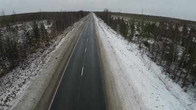 Flying over empty road in the north