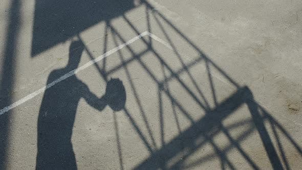 Shadow of sportsman dribbling a ball and shooting it through the basket, career