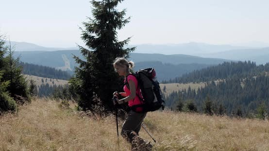 Thumbnail for Woman Hiking in Mountains with Backpack, Enjoying Her Adventure. Slow Motion V2