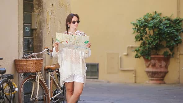 Thumbnail for Beautiful Woman Looking at Touristic Citymap in Rome, Italy. Happy Girl Enjoy Italian Vacation