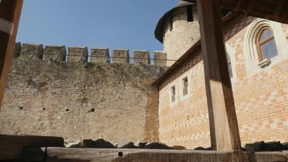 A stone wall and a brick wall