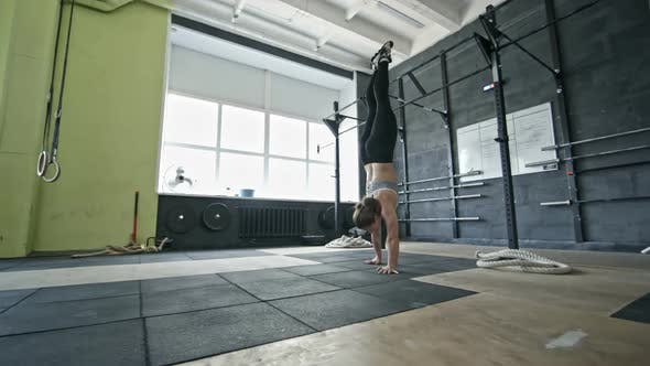 Thumbnail for Female Athlete Walking on Hands in Gym