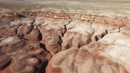 Rising aerial view over eroded desert in the desert