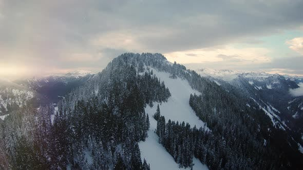 Cover Image for Mountain Top Winter Aerial With Snow Falling On Cascade Range