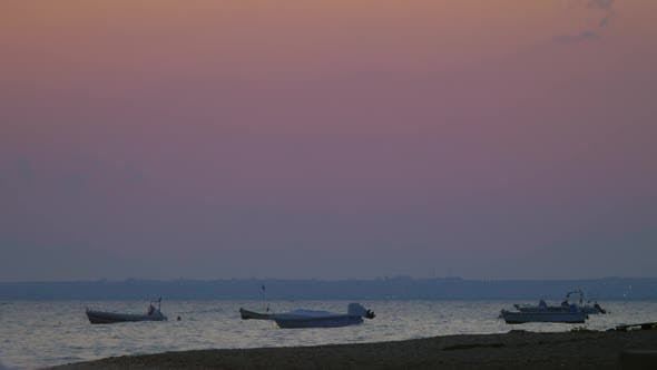 Thumbnail for Moored Motor Boats Rocking on Sea Waves in the Dusk