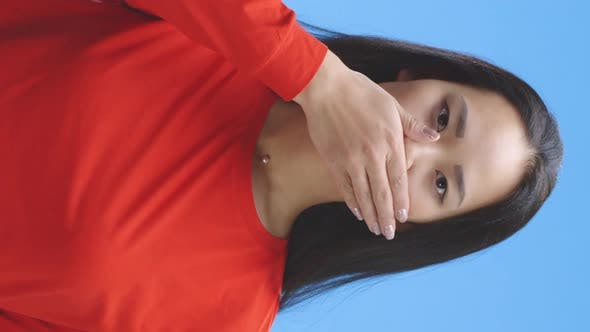 Young Woman Silencing Herself
