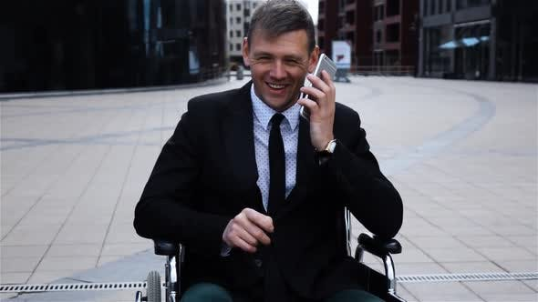 Thumbnail for Disabled Invalid Businessman Talking By Smartphone