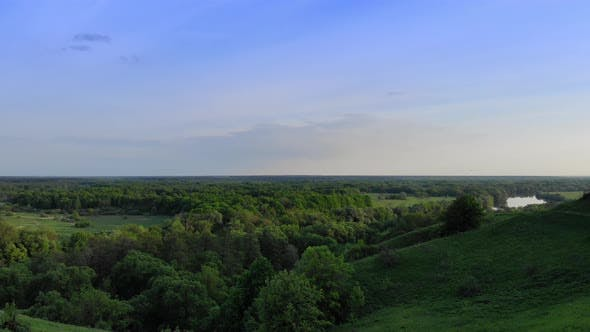 Thumbnail for Aerial View of Green Summer Forest and Canyon at Sunset