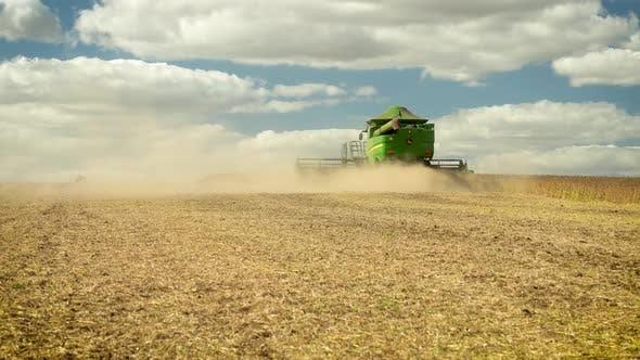Combine Harvester Leaving Soybean Field