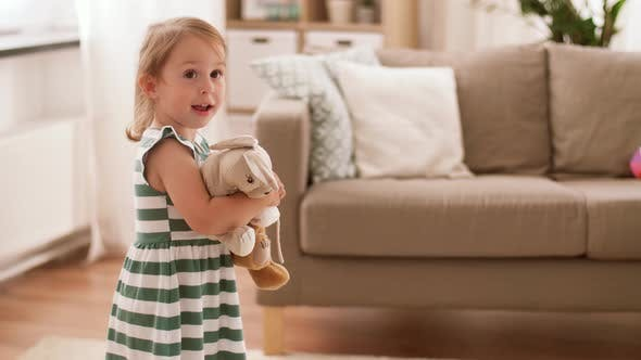 Thumbnail for Happy Baby Girl with Soft Toys at Home