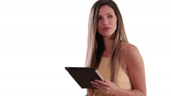 Thumbnail for Happy white woman using tablet computer and smiling on solid white background