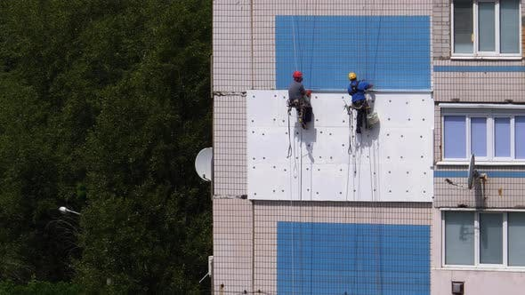 Two Industrial Climber, Insulation Facade of High-rise Building Using Styrofoam