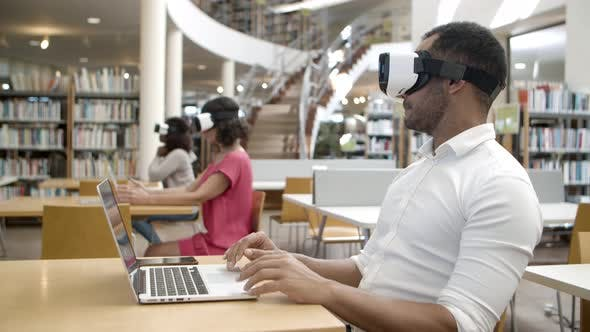 Thumbnail for Side View of Young Man Wearing Virtual Reality Glasses