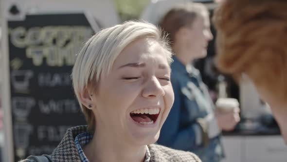 Cover Image for Young Woman Laughing at Joke in Slow Motion
