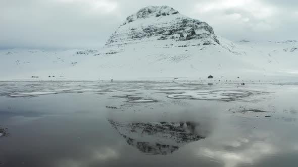 Thumbnail for Bird's-eye View of the Snowy Mount Kirkjufetl. Iceland, Winter 2019