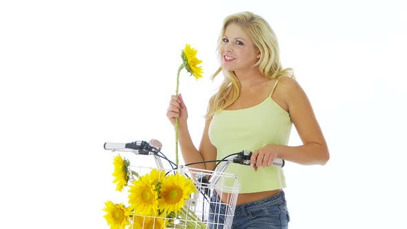 Thumbnail for Woman on bike with sunflowers