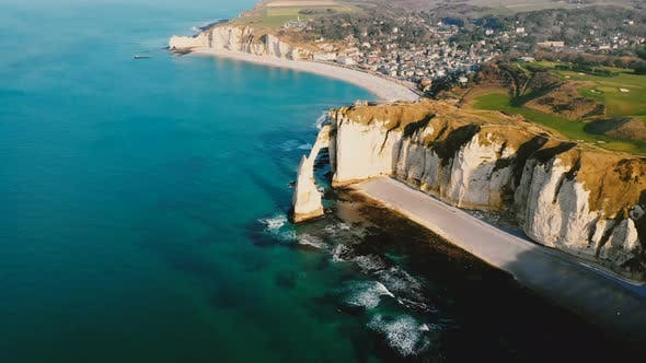 Thumbnail for Drone Panning Right High Above Epic Sunset Sea Shore with White Chalk Cliff Coastline and Beautiful