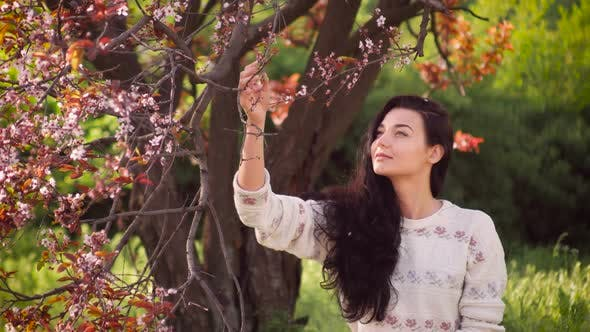 Thumbnail for Woman and Falling Petals of Sakura on Nature