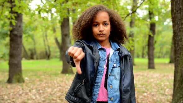 Thumbnail for Young African Sincere Girl Shows Thumb Down As Disagree - Eye Contact - Say No