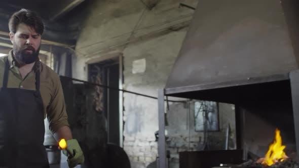Thumbnail for Blacksmith Working in Smithy