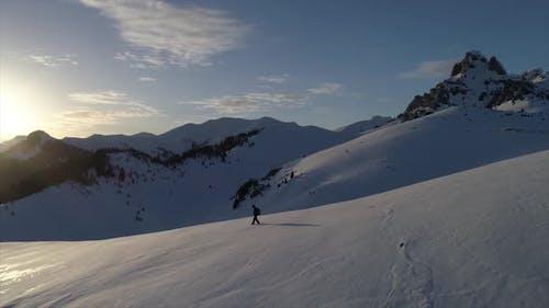 Mountain Climbers In Winter