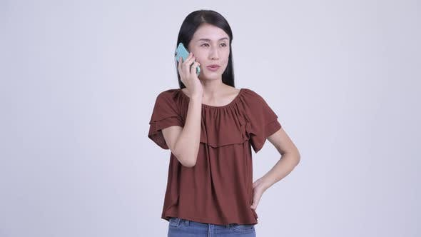 Cover Image for Happy Beautiful Asian Woman Talking on the Phone