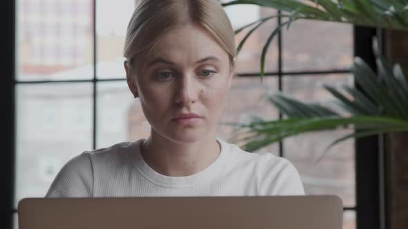 Thumbnail for Thoughtful concerned woman working on laptop computer looking away thinking solving problem