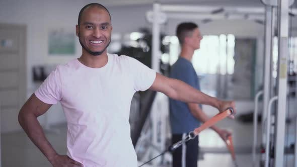 Thumbnail for Happy Male Is Rising Weight with One Hand Easily in the Gym People in the Gym Fitness Therapy