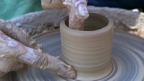 Thumbnail for Potter's Hands Work with Clay on a Potter's Wheel. Slow Motion